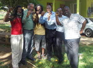 Members of the South African Delegation with His Worship the Mayor, Bertel Moore (Second from left), alongside 'Tuffist' (far left) and Donovan (centre) at the Peter Tosh Monument in Belmont, Westmoreland.